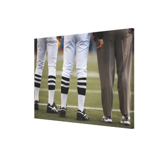 American football players and coach standing on canvas print