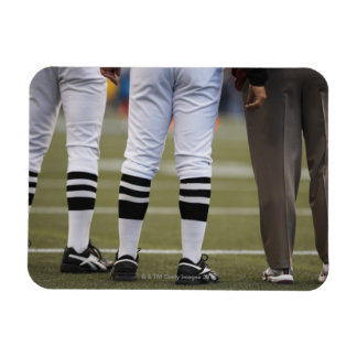 American football players and coach standing on rectangular photo magnet