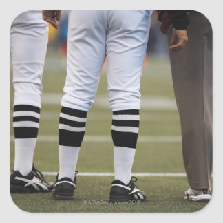 American football players and coach standing on square sticker