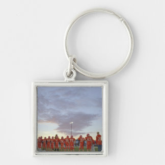 American football players including teenagers key ring