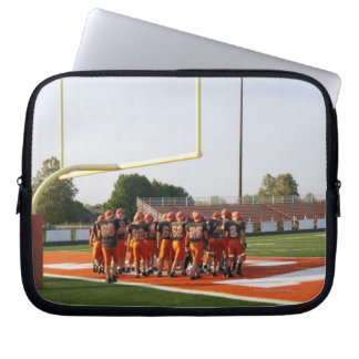 American football players, including teenagers laptop computer sleeve