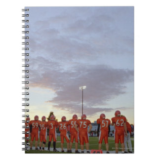 American football players including teenagers notebook