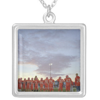 American football players including teenagers silver plated necklace