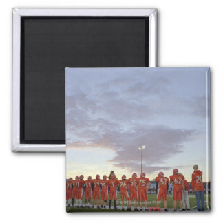 American football players including teenagers square magnet