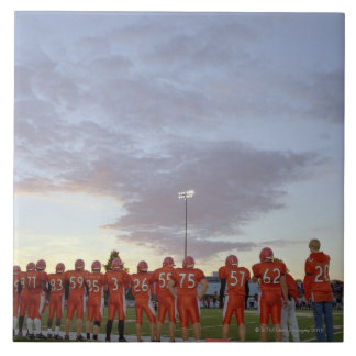 American football players including teenagers tile