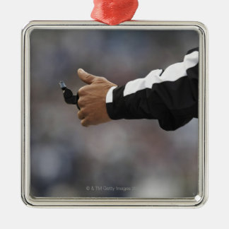 American football referee holding whistle, Silver-Colored square decoration