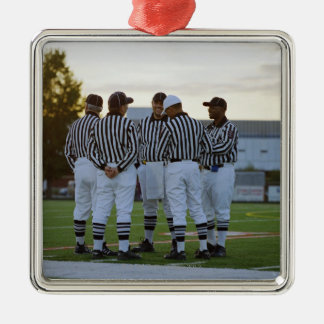 American football referees talking in field christmas ornament