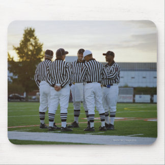 American football referees talking in field mouse mat