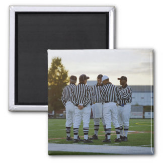American football referees talking in field square magnet
