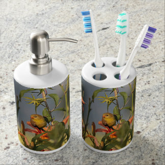 American goldfinch in the garden with day lilies soap dispenser and toothbrush holder
