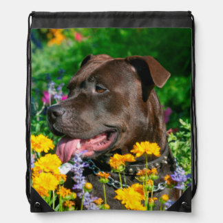 American Pit Bull in field of flowers Drawstring Bag