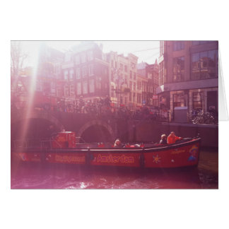 amsterdam canal view with front of cruise boat card