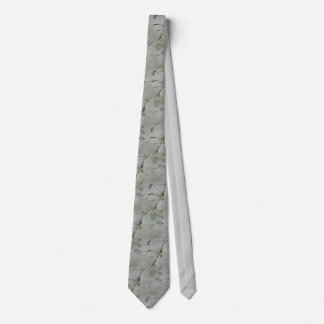 An abstract tie with rolling patterns of grey.