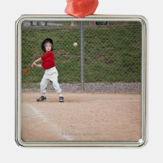An action shot of a 5 year old baseball player christmas ornament