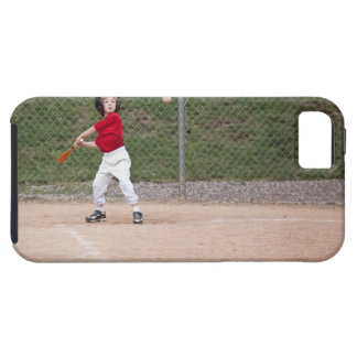 An action shot of a 5 year old baseball player tough iPhone 5 case