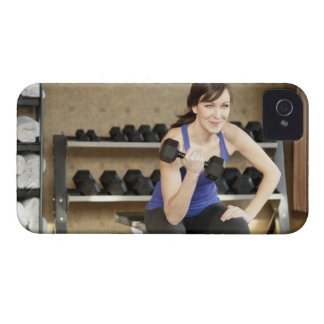 An active female lifting weights in a private iPhone 4 cover