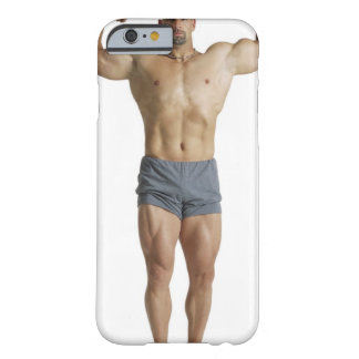 an adult caucasian male bodybuilder holds his barely there iPhone 6 case