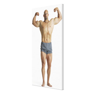 an adult caucasian male bodybuilder holds his canvas print