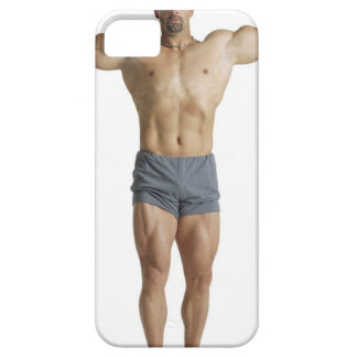 an adult caucasian male bodybuilder holds his iPhone 5 cases