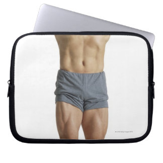 an adult caucasian male bodybuilder holds his laptop sleeve