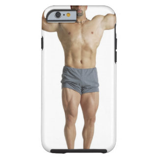 an adult caucasian male bodybuilder holds his tough iPhone 6 case