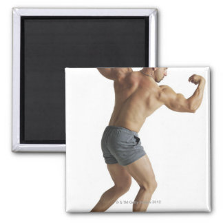 an adult caucasian male bodybuilder shows off square magnet