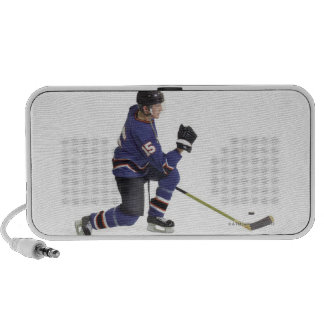 an adult caucasian male hockey player in a blue travelling speakers