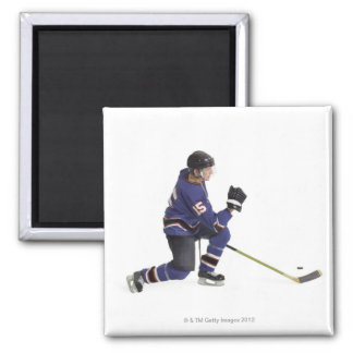 an adult caucasian male hockey player in a blue square magnet