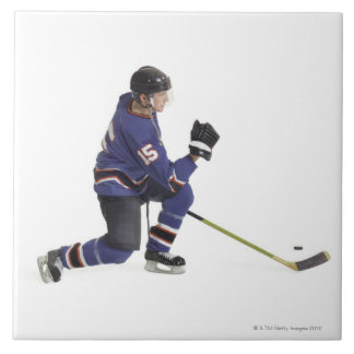 an adult caucasian male hockey player in a blue tile