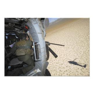 An aerial gunner scans terrain photo print