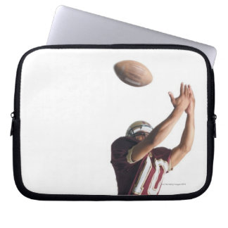 an african american football player in a red and laptop sleeve