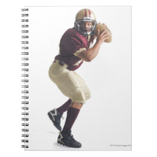 an african american man in a red and white spiral note books