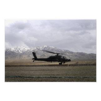 An AH-64A Apache taking off Photo Print