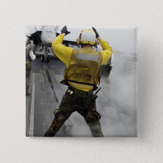 An aircraft director signals a F/A-18C Hornet 15 Cm Square Badge