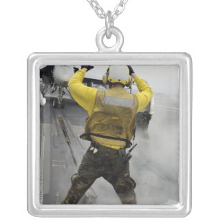 An aircraft director signals a F/A-18C Hornet Silver Plated Necklace
