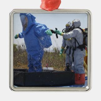 An airman stands in a tub christmas tree ornament