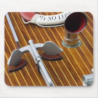 An Anchor And A Life-Buoy On A Wooden Boat Mouse Mat