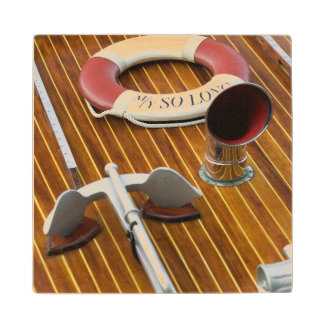An Anchor And A Life-Buoy On A Wooden Boat Wood Coaster