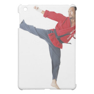 an asian male karate black belt wearing a red case for the iPad mini