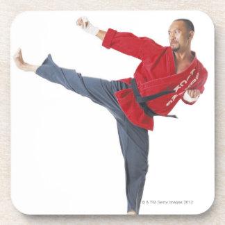 an asian male karate black belt wearing a red coaster