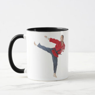 an asian male karate black belt wearing a red mug