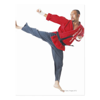 an asian male karate black belt wearing a red post card