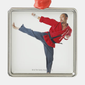 an asian male karate black belt wearing a red Silver-Colored square decoration
