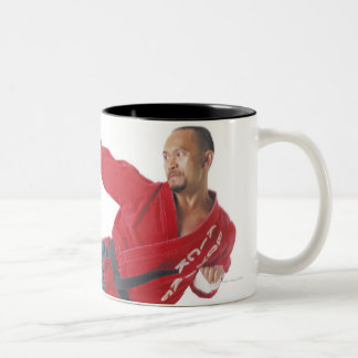 an asian male karate black belt wearing a red Two-Tone coffee mug