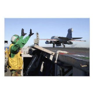 An EA-6B Prowler launches from the flight deck Photo Print