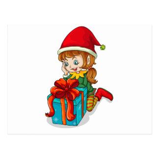 An elf beside a gift postcard