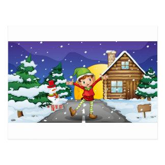 An elf enjoying the snow postcard