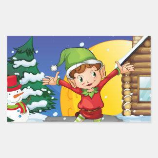 An elf enjoying the snow rectangular sticker