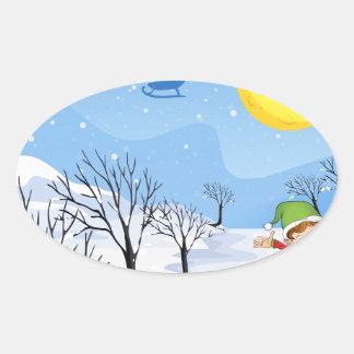 An elf in a snowy place oval sticker