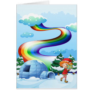 An elf near the igloo with a rainbow in the sky greeting card